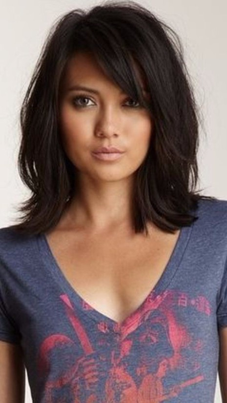 1. Medium Length with Volume and Bangs