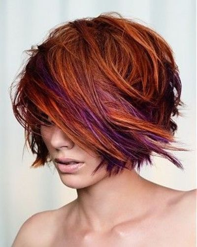#10. Choppy Bob with Bright Violet and Orange Highlights