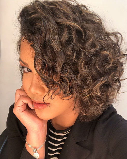 21. Side-swept Curly Hair