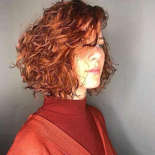 24. Short Curly Red Hair