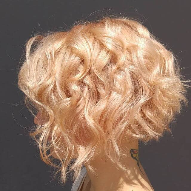 3. Strawberry Gold Short Curly Hair