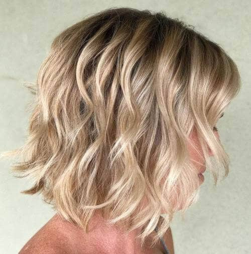 6. Wavy Bob Haircut Style with Layers