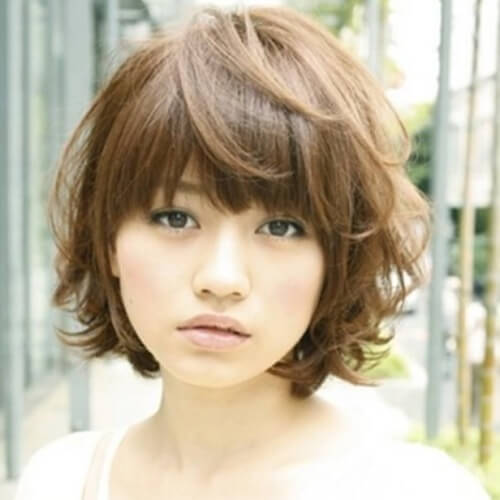 9. Full Bangs for Thick Hair