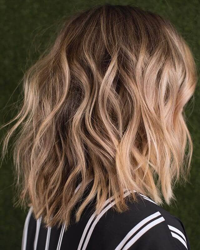 9. Layered Shag with Beachy Waves