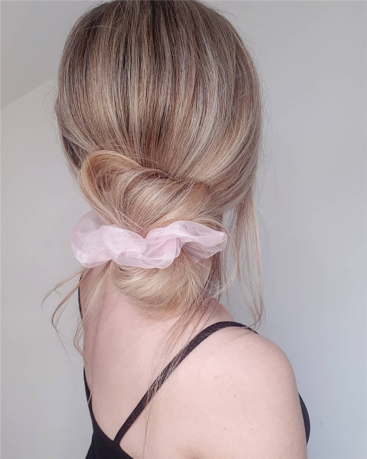 Low messy Bun with a Pinky Scrunchie