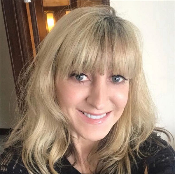 Medium Blonde Hairstyle for Over 50